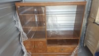 brown wooden framed glass cabinet Kankakee, 60901