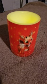 red and yellow candle holder