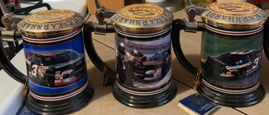 Photo Dale Earnhardt collectible mugs. A complete set by Franklin Mint