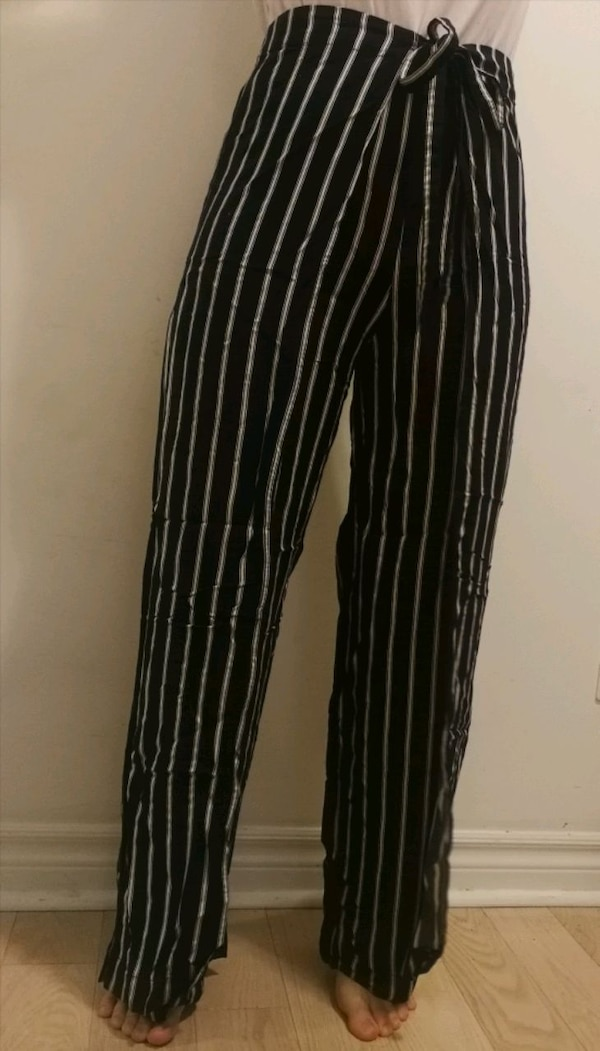 Striped pants with tie-up side panels b30d2b88-162d-4b1a-bf1d-28d50ca07605