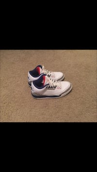 pair of white-blue-and-red Air Jordan basketball shoes