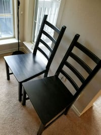 two black wooden framed white padded chairs Tysons, 22102
