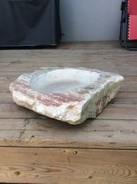 Bird bath or outdoor dog dish.  Granite and signed by the carver