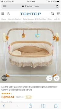 Baby's white and brown bassinet sing with remote control  Airdrie, T4B 4K3