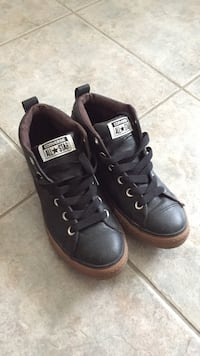 pair of black leather Converse All Star low top sneakers Toronto, M4B 3N5