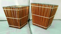two brown wooden folding chairs