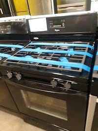 Whirlpool black gas stove in excellent condition