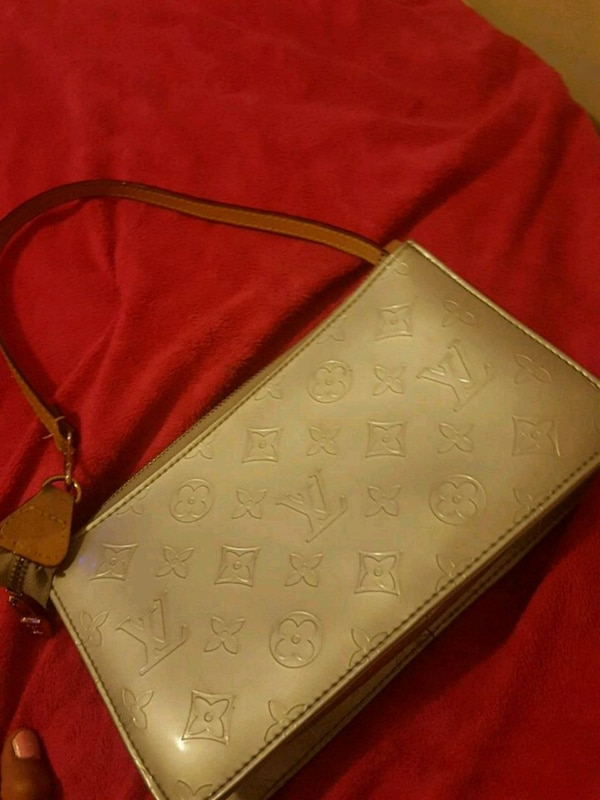 pink monogram Coach leather wristlet