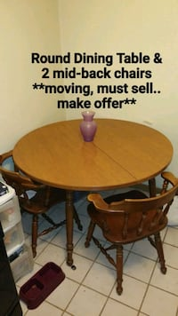 Moving, must sell _ Round dinner table & 2 chairs Cedar Rapids