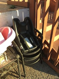 baby's black plastic car seat carrier base