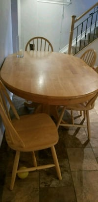 round brown wooden table with six chairs dining s Toronto, M9V 2V2
