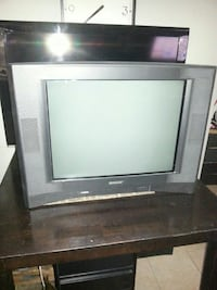 gray CRT television with remote