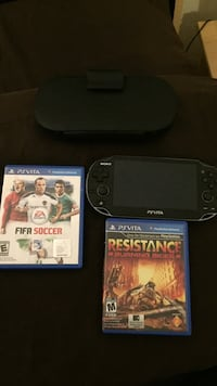 Ps vita with 2 games and case Toronto, M5V 4A6