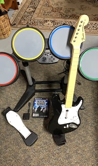 Rock Band Guitar and Drumset along with game and foot pedal