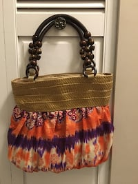 brown, orange, and black floral handbag