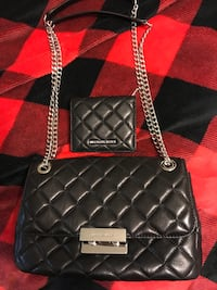 Quilted black Michael Kors leather clutch bag with wallet
