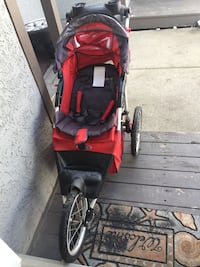 baby's black and red jogging stroller