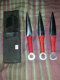 3 black and red kunai and case