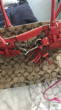 red and black Coach leather tote bag Miami Beach, 33139