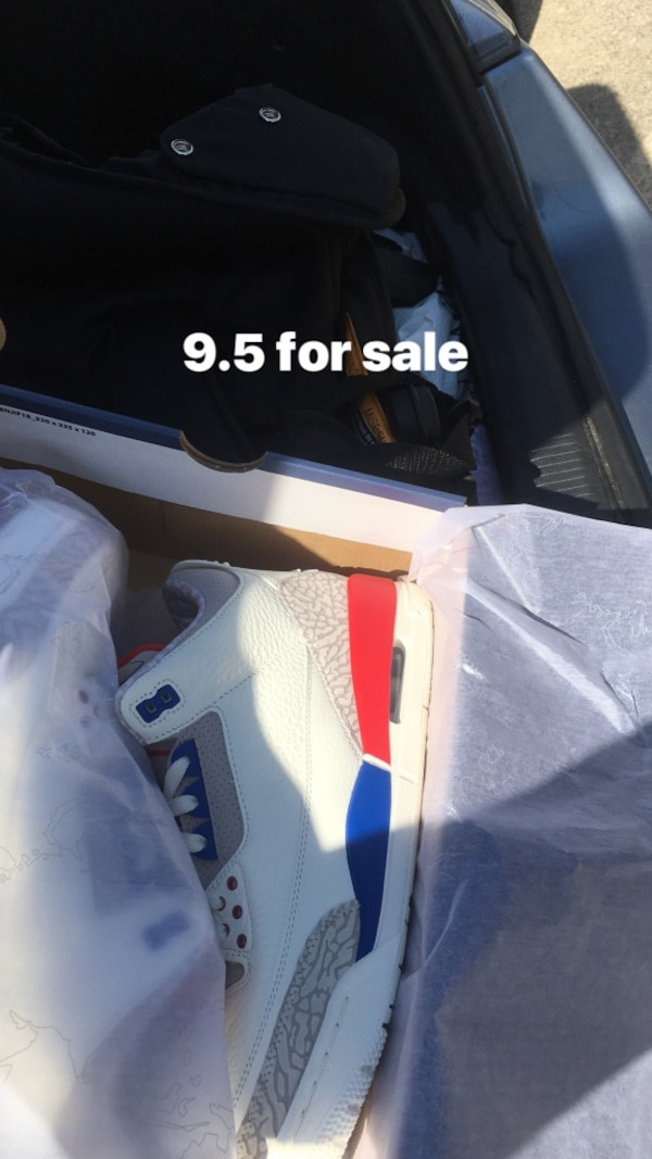 Pair of white Air Jordan 3's
