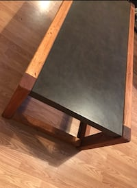 Table: Natural wood frame w/ a chocolate hard laminate surface. Monroe, 71203