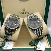 two round silver-colored Rolex analog watches with boxes California