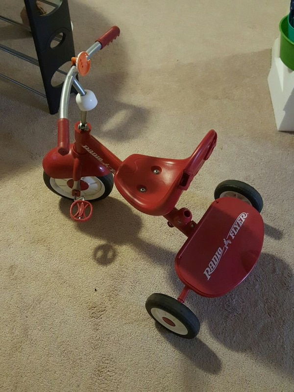 toddler's red Radio & Flyer trike 4bfc65df-ad7e-4cfa-902f-4ad3bc884c68