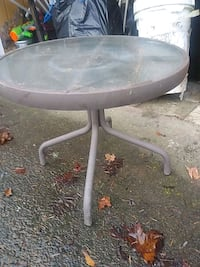 Side glass patio table