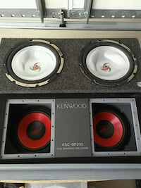 two black and gray subwoofer speakers