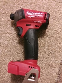 red and black Milwaukee cordless impact wrench Durham, 27705