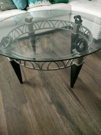 Bevealed round glass top table with black metal base Richmond Hill, L4E 3T2