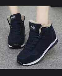 pair of black-and-white Wollys sneakers