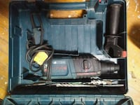 blue and black Bosch rotary hammer drill with case 3731 km