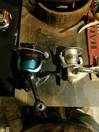 two white and blue fishing reels