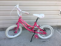 children's pink bicycle with side stand
