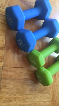 two green and blue dumbbells 21 mi