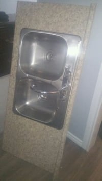 Sink with counter top and other faucet