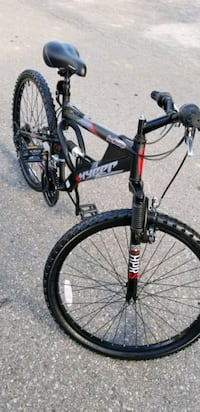 black and red full suspension mountain bike Toronto, M9V 2E4