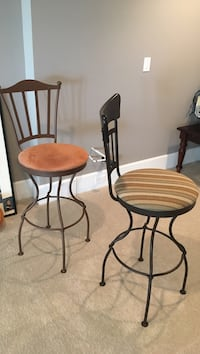 two black-and-brown steel padded bar stools Langley