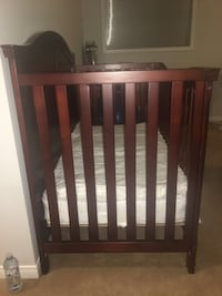 baby's brown wooden crib Whitby, L1P 0A4
