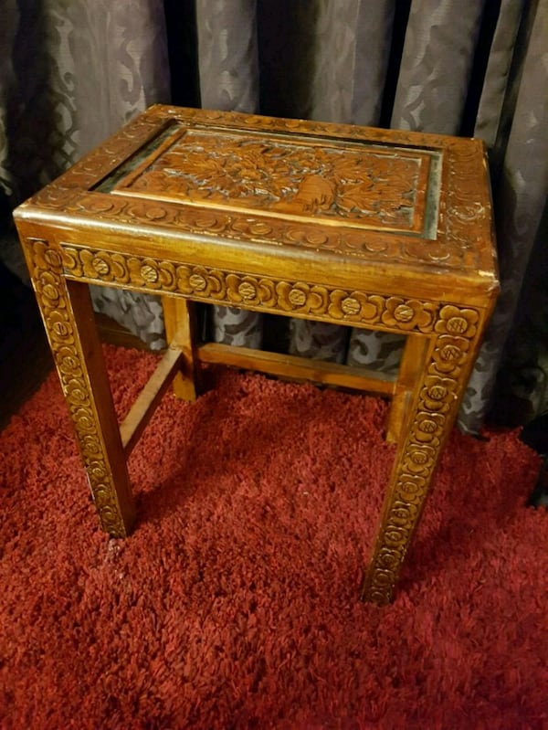Carved side table 36113179-c388-40e8-bff7-9244fbd9790b