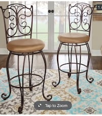 Brand new four luxury tall swivel bar stools   Its real heavy, sturdy, swivel, tall bar stools and beautiful design  Brand new never used doesn't match our furniture   Each one cost $199.99 plus tax   Modesto, 95356