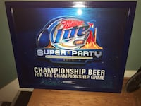 blue and red Miller Lite Super Party pub mirror with black frame