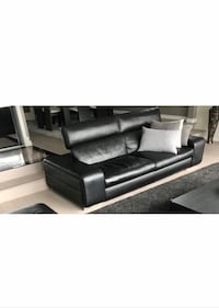 Real leather black sofa with coffee table in excellent condition 9.5/10 566 km
