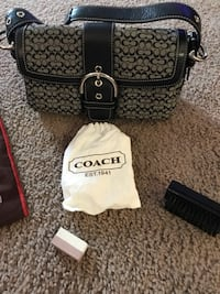 BRAND NEW COACH HANDBAG with cleaner and more