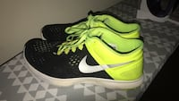 black-and-green Nike running shoes