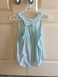 Turquoise and white Ivivva tank size 12 Okotoks, T1S 2M6