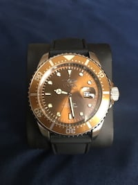 round gold-colored Invicta analog watch with black leather band Ashburn, 20148