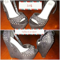 pair of studded black leather ankle-strap peep-toe wedge sandals
