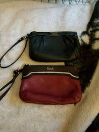 two black and red Coach leather wristlet